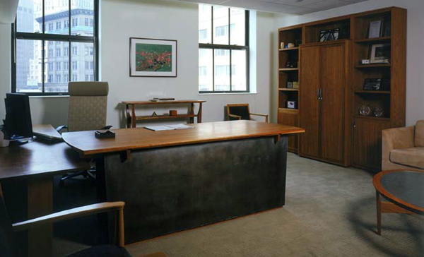 executive office with furniture in cherry and oxidized zinc