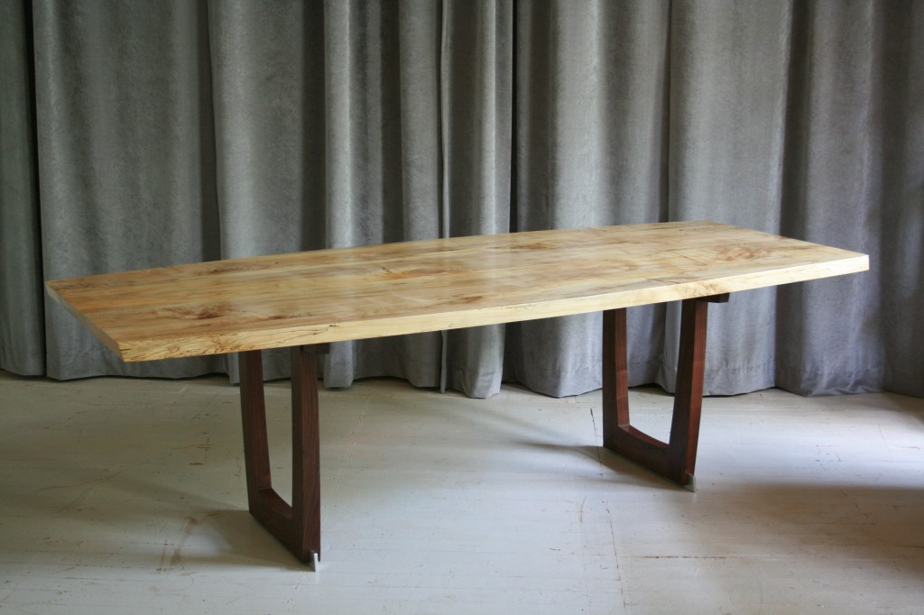 A Bowed Trestle Table in Spalted Maple, Black Walnut, and Brushed Aluminum
